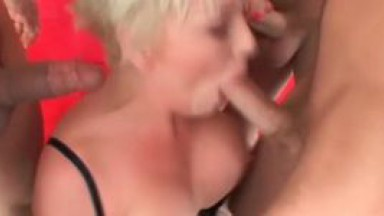 Busty blond hooker gets ass and mouth